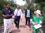 Preserve Manager Mark Daniels and BNT Executive Director Eric Carey join Shelby White and Prime Minister Christie for a stroll on the trails